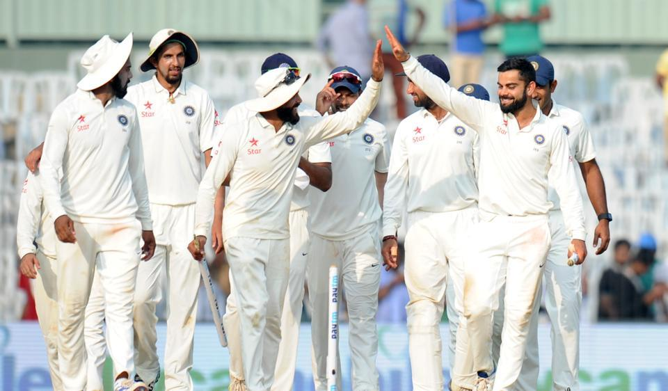 Indian cricket captain Virat Kohli (R) celebrates with teammates after winning the fifth Test match against England in Chennai.