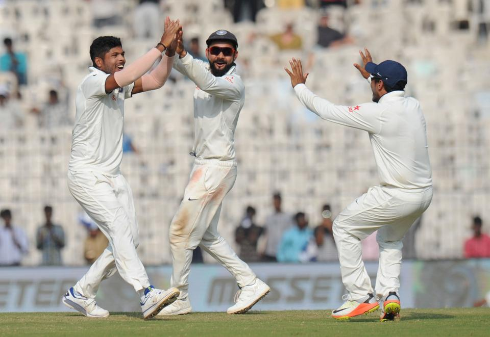 India's Umesh Yadav (L) celebrates the wicket of England's Adil Rashid along with captain Virat Kohli on Day 5 in Chennai.
