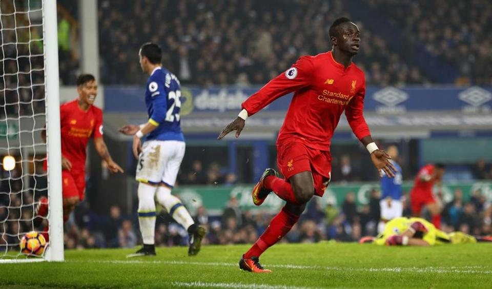 Sadio Mane of Liverpool celebrates after scoring the winning goal in injury time during the Premier League match between Everton and Liverpool at Goodison Park.