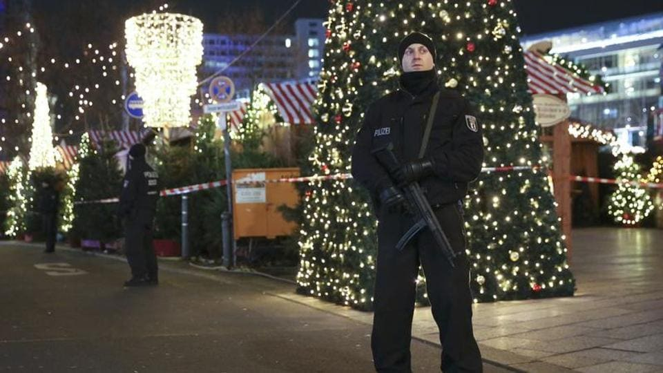 German police officers secure the site of a tragedy after a truck ran into a Christmas market on Breitscheidplatz square near the fashionable Kurfuerstendamm avenue in the west of Berlin.