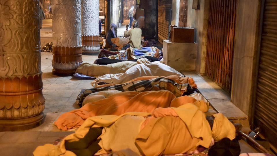 Homeless people sleep near Old Delhi railway station in New Delhi. (Sanjeev Verma/HT PHOTO)