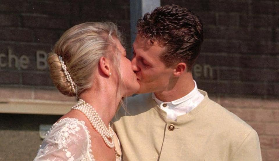 Formula one champion Michael Schumacher kisses his bride Corinna after their marriage on August 1, 1995 at Kerpen city hall. (File photo)