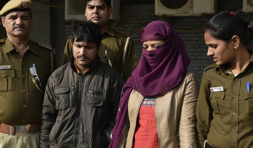 Arjun Thapa (left) with his partner Neha in police custody. They are prime accused in the double murders reported from Munirka. In both cases the bodies of the victims were decapitated.