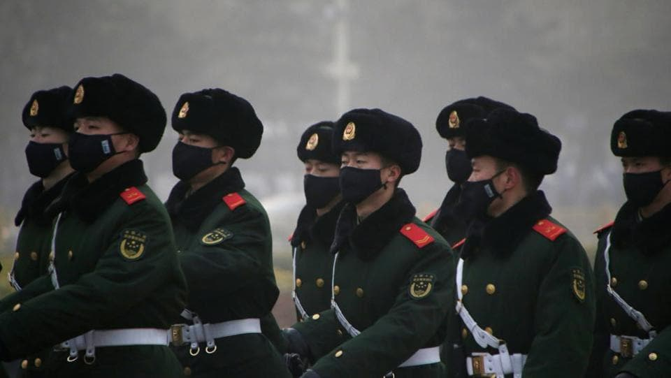 Paramilitary police officers wearing masks on patrol at Tiananmen Square in Beijing. (Reuters photo)