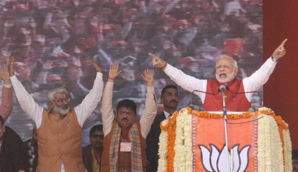 Prime Minister Narendra Modi addresses the BJP Parivartan Rally in Kanpur.  Modi urged the Election Commission  to pressure political parties to create transparency over the donations they get