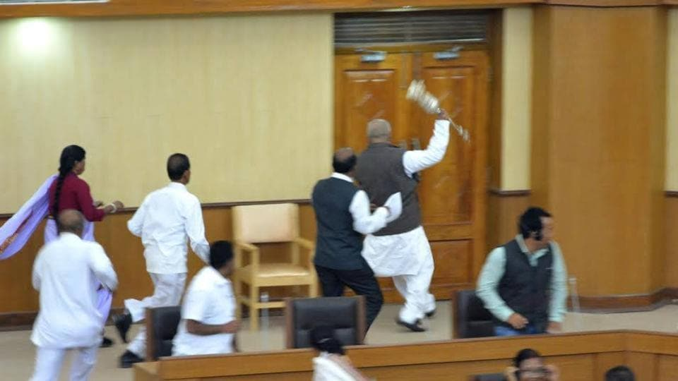 Video Grab of TMC MLA Sudip Roy Barman running away with Speaker's mace during the last day of the winter session.