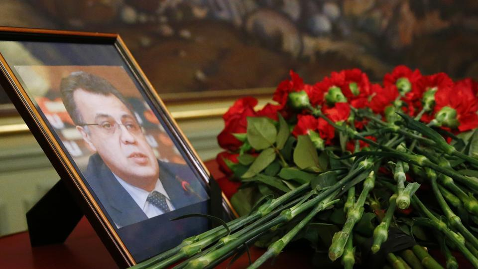 Flowers lay next to a portrait in memory of Russian Ambassador to Turkey Andrei Karlov, who was fatally shot by a Turkish policeman.