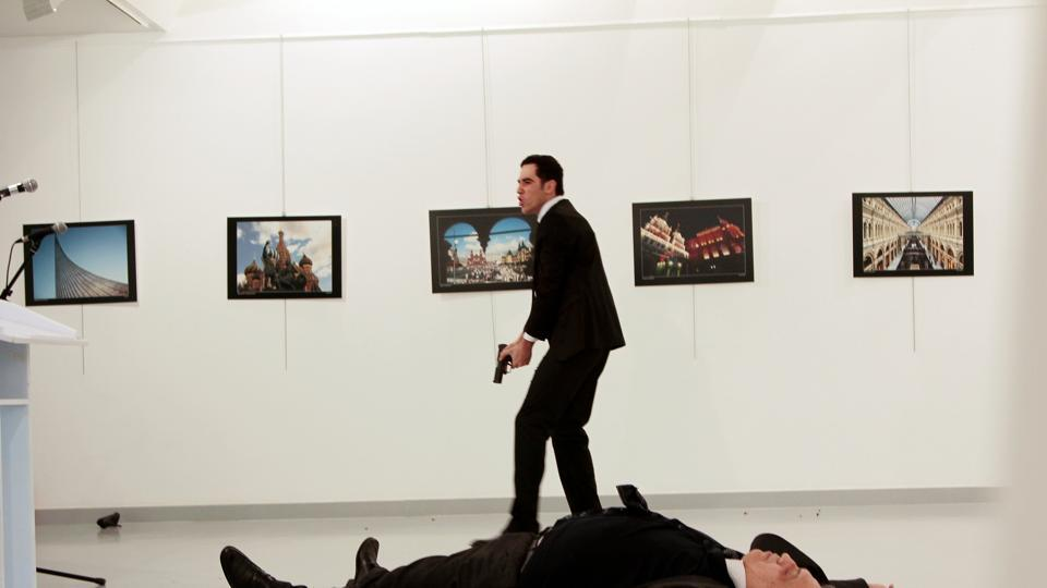 Russian ambassador to Turkey Andrei Karlov lies on the ground after he was shot by Mevlut Mert Altintas at an art gallery in Ankara.