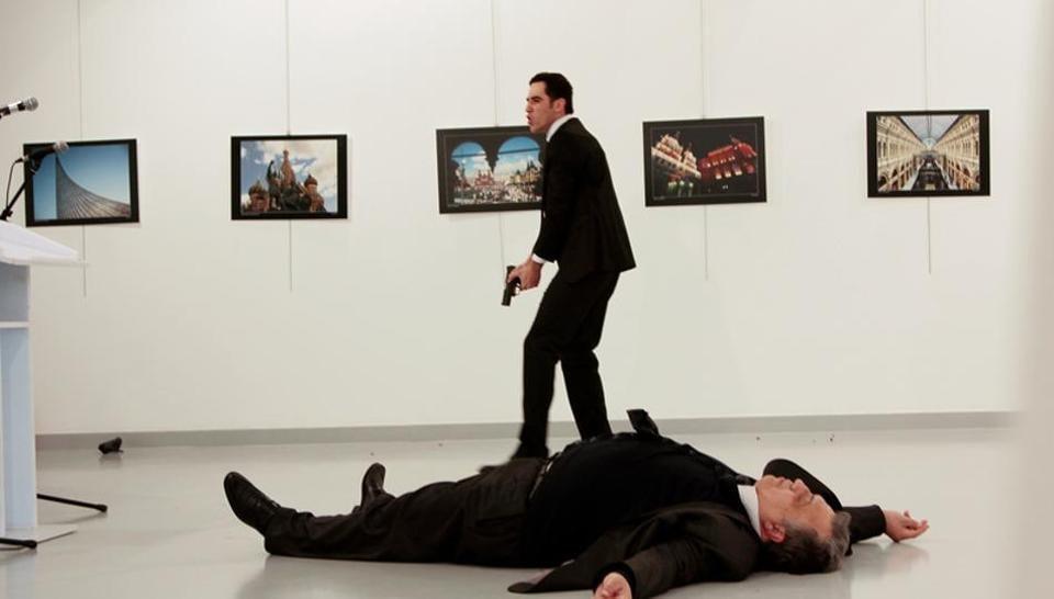 Russian Ambassador to Turkey Andrei Karlov lies on the ground after he was shot by Mevlut Mert Altintas at an art gallery in Ankara, Turkey, December 19, 2016.