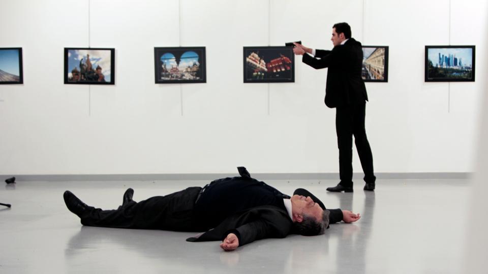 Russian ambassador to Turkey Andrei Karlov lies on the ground after he was shot by Mevlut Mert Altintas at an art gallery in Ankara, Turkey, on December 19, 2016.