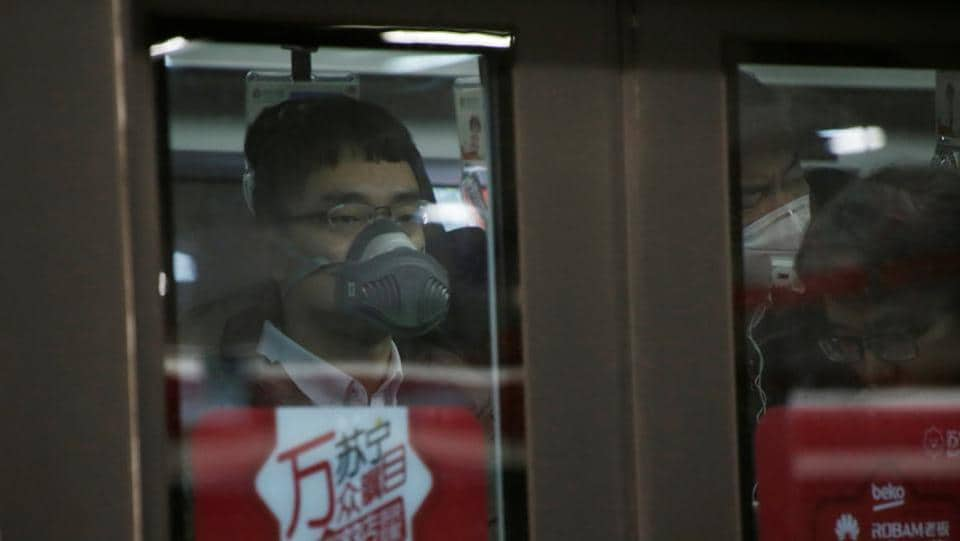 A man wears a respiratory protection mask while riding a subway in Beijing. (Reuters photo)