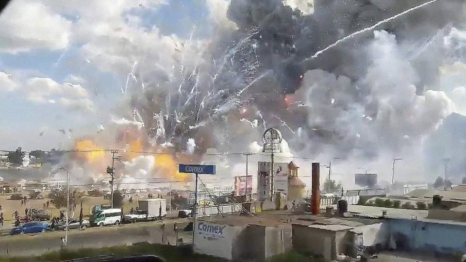 This image made from video recorded from a passing car shows an explosion ripping through the San Pablito fireworks' market in Tultepec, Mexico, Tuesday, Dec. 20, 2016.