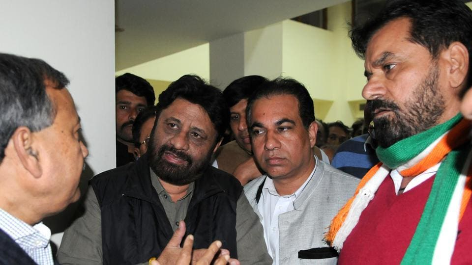 Congress leaders Pardeep Chhabra and Subhash Chawla arguing with UT state election commissioner SK Srivastava (extreme left) at the UT guesy House.