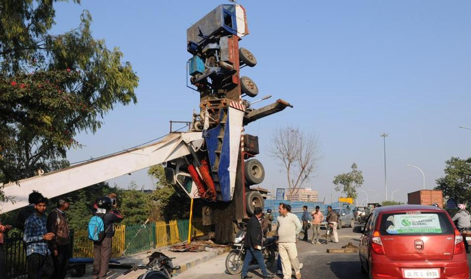 A big crane turned upside down on Wednesday afternoon and remained suspended throughout the day on the busy road near Shahdara drain, adjoining Sector 14-A .