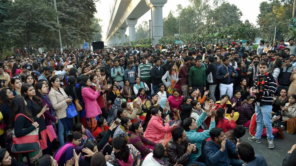 Scores of guest teachers staged a protest against AAP government after a function outside North Delhi's Chhatarsal Stadium on Wednesday.