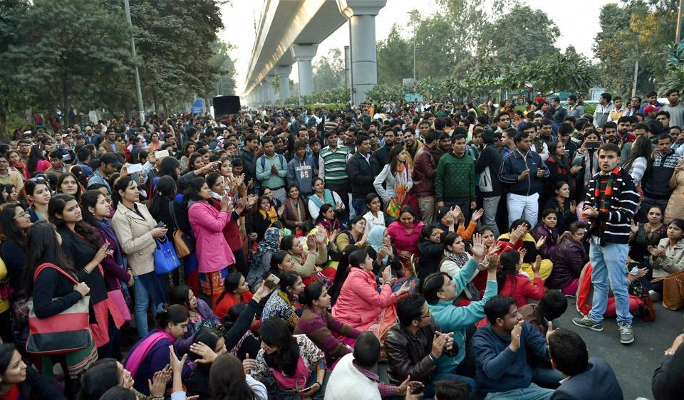Scores of guest teachers staged a protest against AAP government after a function outside North Delhi's Chhatarsal Stadium on Wednesday