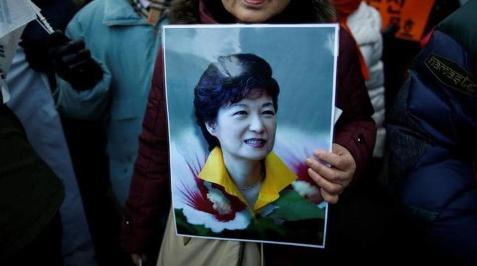 A supporter holds a portrait of South Korean President Park Geun-hye during a protest opposing her impeachment near the constitutional court in Seoul, South Korea.