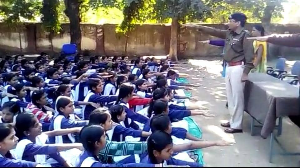 Girls students being administered oath that they would study till 18 years,under an initiative taken by Jhabua police.