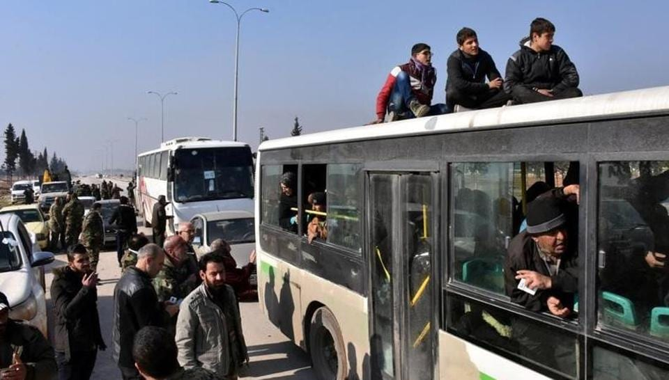People who fled the Shi'ite Muslim villages of al-Foua and Kefraya arrive in government controlled Jibreen area in Aleppo, Syria in this handout picture provided by SANA on December 19, 2016.