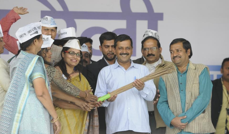 AAP workers presenting broom to Delhi chief minister Arvind Kejriwal during Parivartan rally organised at Chhola Dussehra ground in Bhopal on Tuesday.