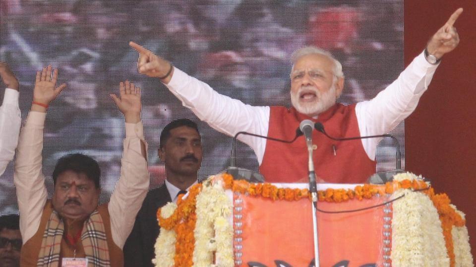 Prime Minister Narendra Modi addresses a BJP Parivartan Rally in Kanpur.