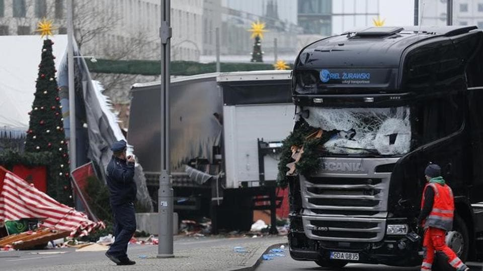 Police stand in front of the truck which ploughed last night into a crowded Christmas market in the German capital Berlin.