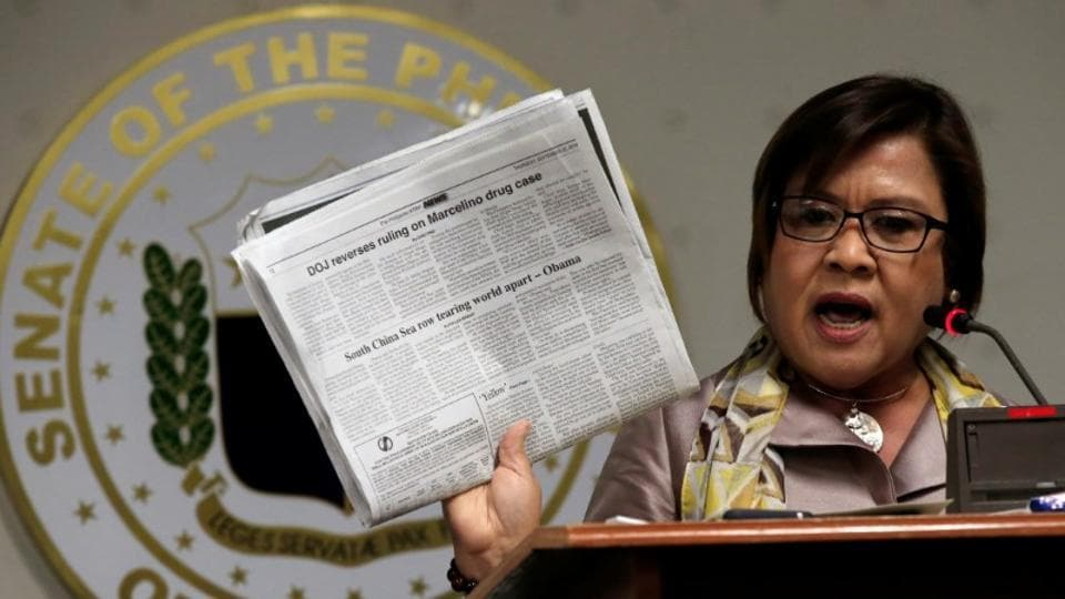 A file photo of former justice secretary and current Senator Leila De Lima showing reporters an article published on a local newspaper during a news conference at the Senate headquarters in Manila, Philippines  on September 22.
