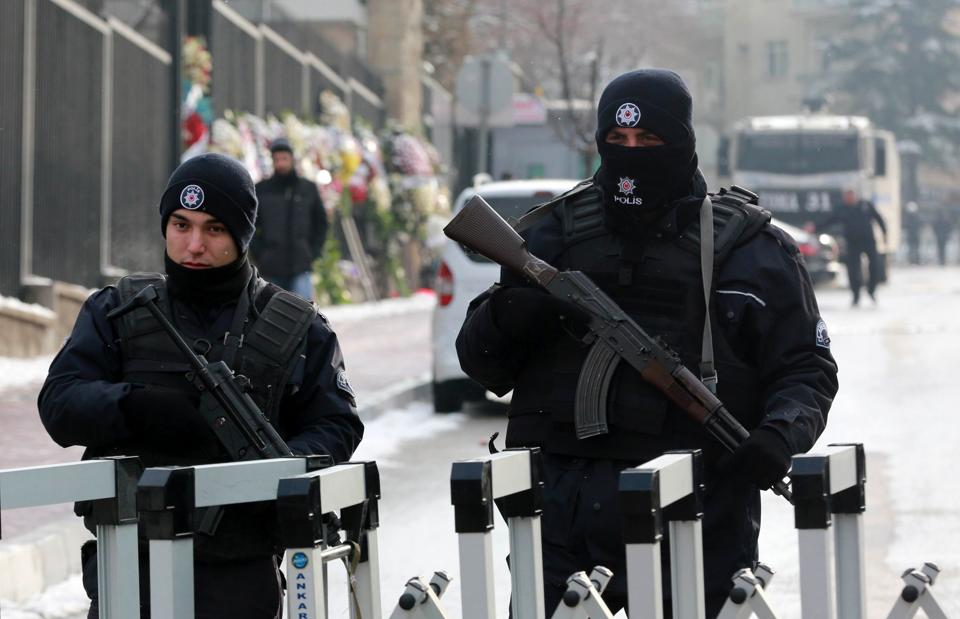 Turkish police officers secure the road leading to the Russian embassy in Ankara on December 21, 2016.