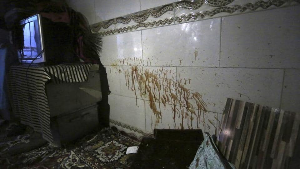 Blood stains are seen on the wall at a parliament member's house after a late night attack in western Kabul, Afghanistan, Thursday, Dec. 22, 2016. Afghan police say gunmen have stormed the home of a lawmaker Mir Wali in the capital, killing eight people and leaving the parliamentarian wounded after he jumped from a roof to escape.