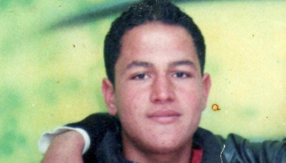 This picture dated Feb. 15, 2009 and provided by Najoua Amri on Thursday, December 22, 2016 shows the fugitive Tunisian suspected in Berlin's deadly Christmas market attack, Anis Amri, posing with a friend in Oueslatia, central Tunisia.