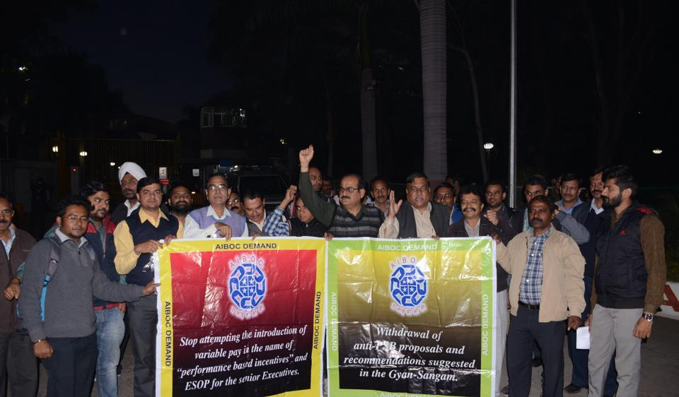 Members of the All India Bank Officers' Confederation stage a protest in front of RBI's regional office in Bhopal on Wednesday against frequent changes in rules after demonetisation.