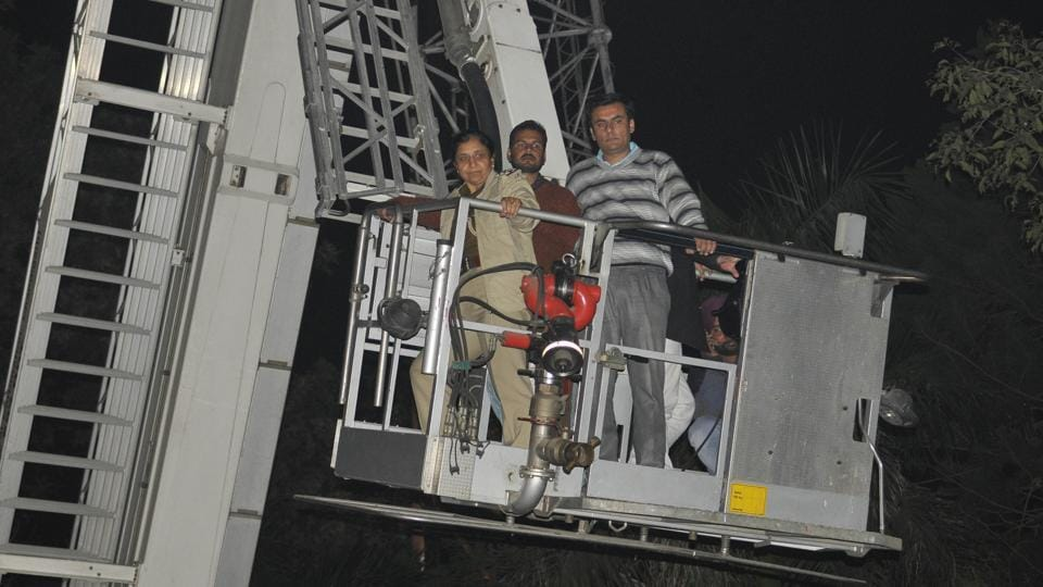 Officials being brought down after hydraulic ladder developed a technical snag in Sector 3, Chandigarh, on Wednesday.