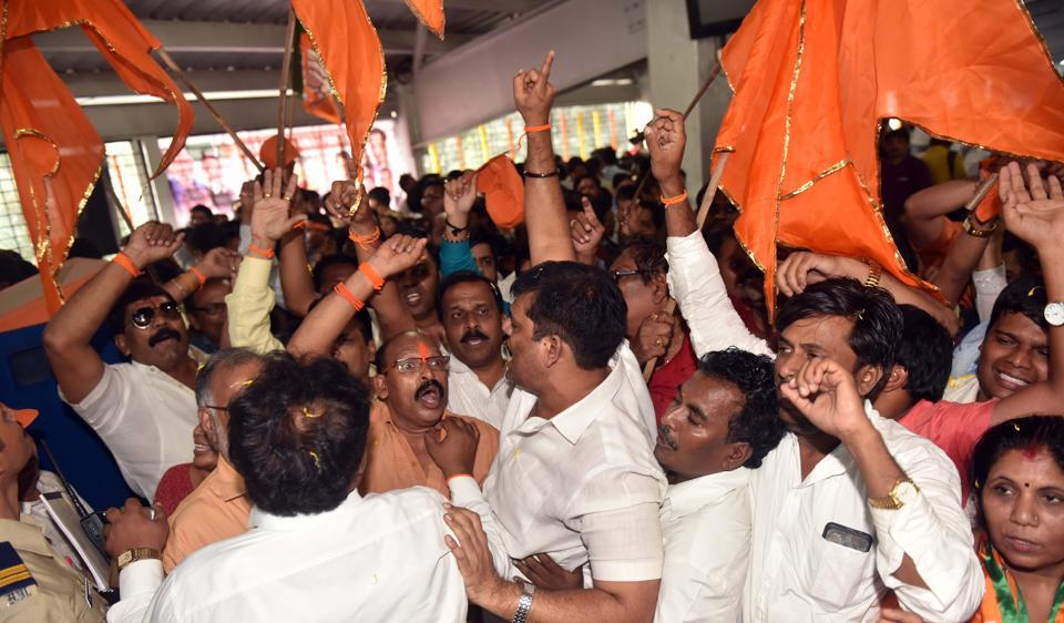 BJP and Shiv Sena supporters tussle during the inauguration of the Ram Mandir station on Thursday.