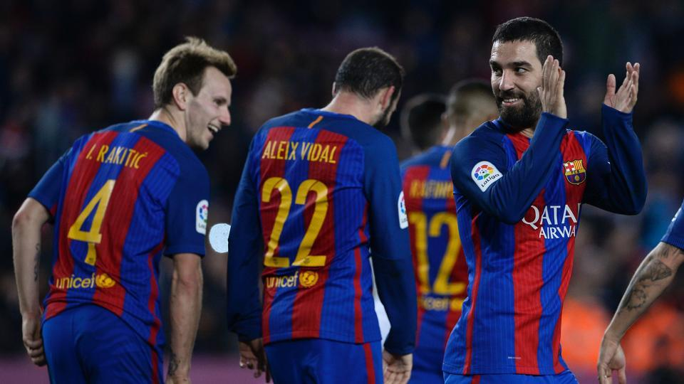 FCBarcelona's Arda Turan (R) celebrates after scoring during the Spanish Copa del Rey (King's Cup) round of 32 second leg football match against Hercules CF.