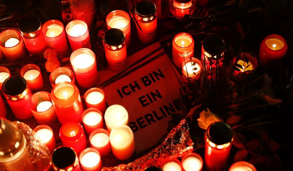 A sign quoting John F Kennedy's sentence 'I am a Berliner'  at a makeshift memorial in front of the Kaiser Wilhelm Memorial Church, two days after an attack at the nearby Christmas market, Berlin, December 21, 2016