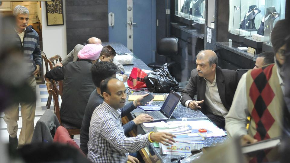 Income tax officials conducting a raid at Khanna Jewellers at College Road in Ludhiana on December 15, 2016.