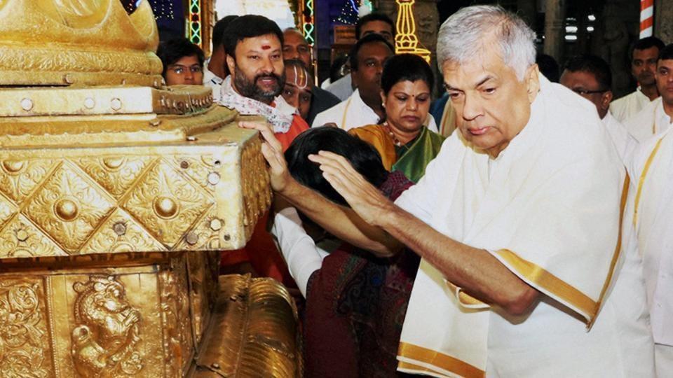 Sri Lankan Prime Minister Ranil Wickremesinghe offers prayers at Lord Venkateswara temple at Tirumala in Tirupati on Thursday.