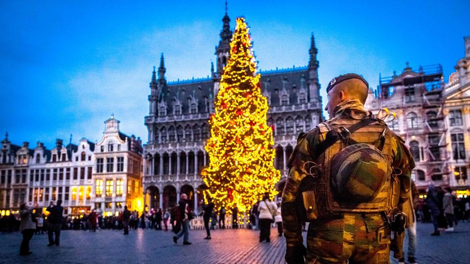 A serviceman patrols the Grand-Place (Groote Markt) during the 'winter wonders' Christmas market in Brussels. The 16th edition of the Christmas market is open till January 1. Security was beefed up across Europe after a lorry ploughed through a market in Berlin on December 19. (AFP photo)