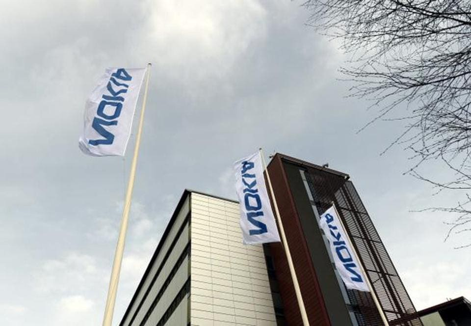 Nokia shares fell by nearly 5 percent on Thursday in Helsinki as analysts warned a legal battle with Apple could delay for years royalty payments that are vital to shoring up the Finnish company's profits.