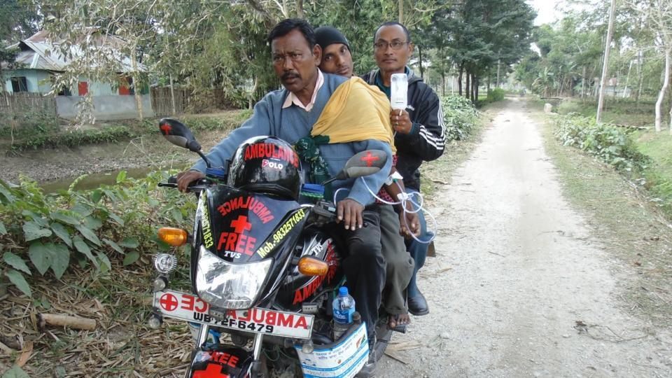 Karimul Haque, a tea garden worker in his early 50s, on his bike, has become the only lifeline for 20 villages in and around Dhalabari.