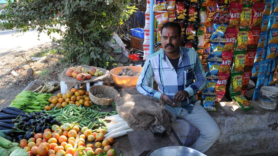 Vegetable vendor Devi Singh Prajapati in Badjhiri village, nearly 25 kms from Bhopal which became the first village in Madhya Pradesh to be declared 'cashless' . HT travelled to the village to do a reality check and spoke to farmers, shopkeepers, traders in the village on the 'cashless' initiative and the overall impact of demonetisation on their lives.