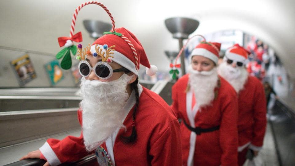 Participants go up the escalator at Clapham Common Underground Station to take part in a charity 'Santa Dash', 5k and 10k runs, around Clapham Common in south London. (Justin TALLIS / AFP)