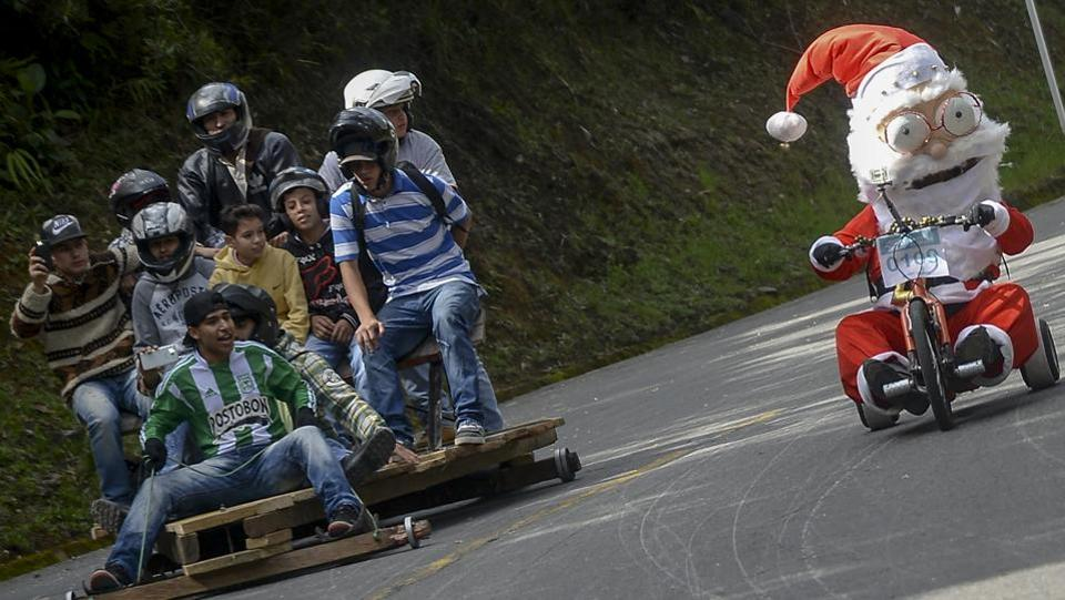 Participants fancy dressed go downhil in the XXVII Car Festival in a homemade cart in the Santa Elena Municipality, near Medellin, Antioquia department, Colombia. (RAUL ARBOLEDA / AFP)