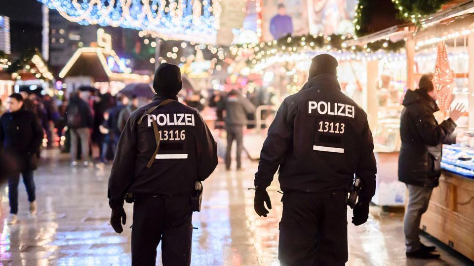 Police patrols at the reopened Christmas market near the Kaiser-Wilhelm-Gedaechtniskirche (Kaiser Wilhelm Memorial Church) in Berlin on Thursday.
