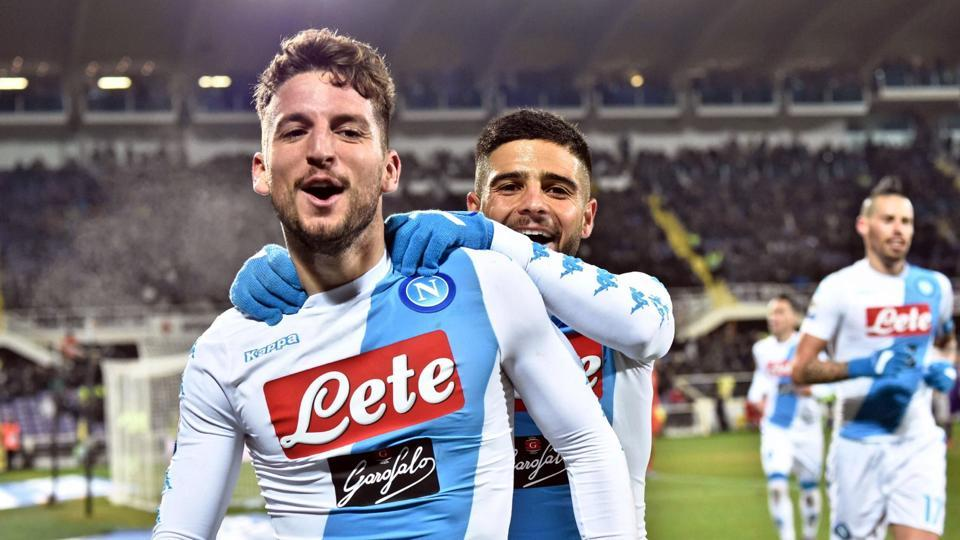 Napoli's Dries Mertens celebrates with his teammate Lorenzo Insigne, right, after scoring during the Serie A match between Fiorentina and Napoli.