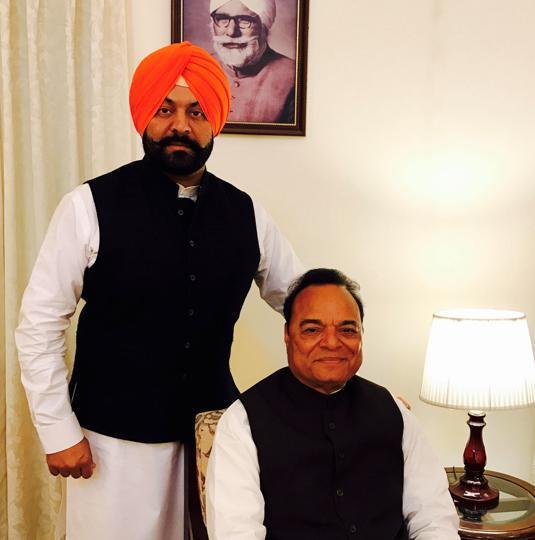 Jalandhar MP Chaudhary Santokh Singh, youngest son of Master Gurbanta Singh (seen in the wall portrait); along with his son Vikaramjit Chaudhary.