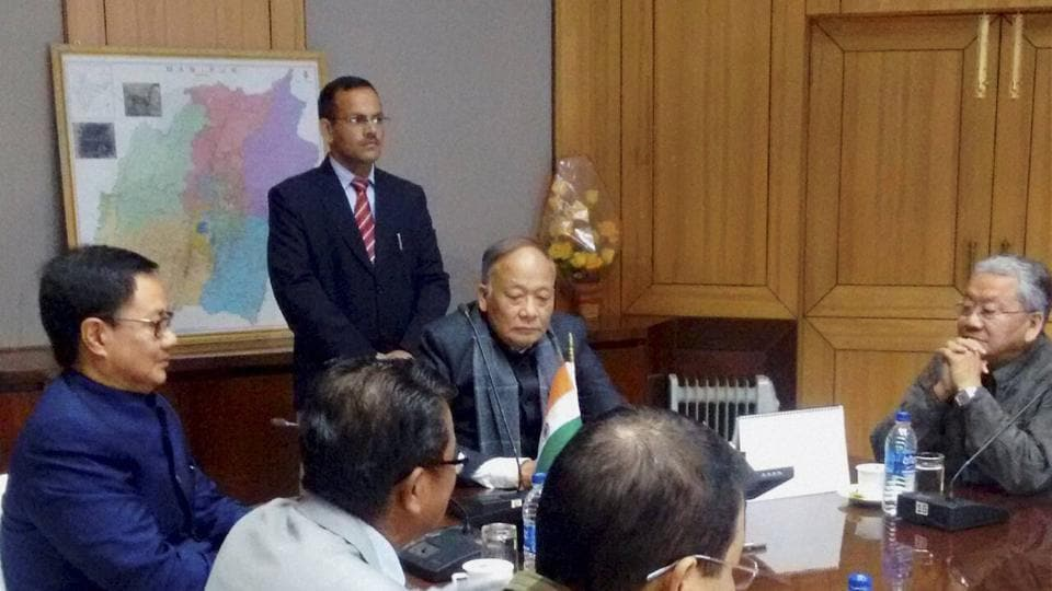 Minister of state for home Kiren Rijiju in a meeting with Manipur chief minister Okram Ibobi Singh in Imphal on Friday.