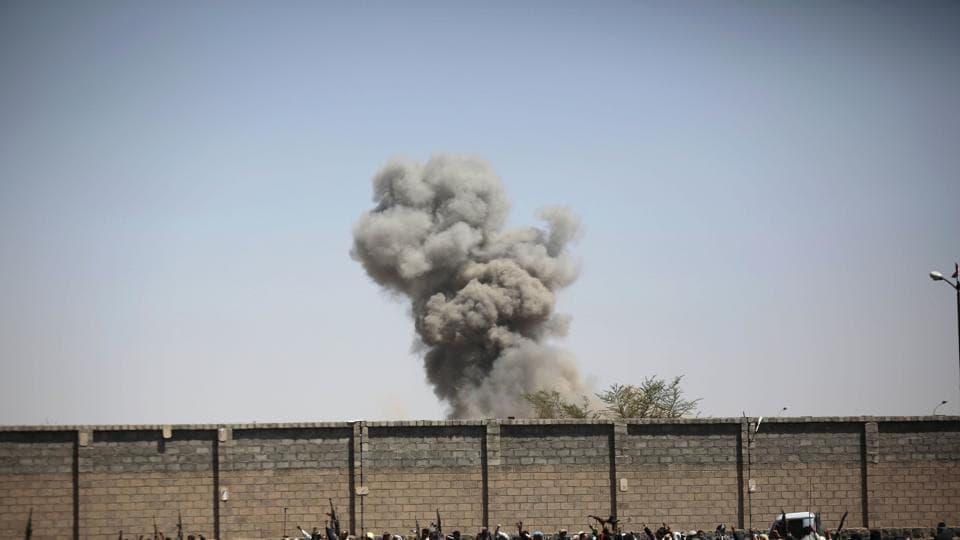 Smoke rises after a Saudi-led airstrike hits an army base in Sanaa, Yemen.