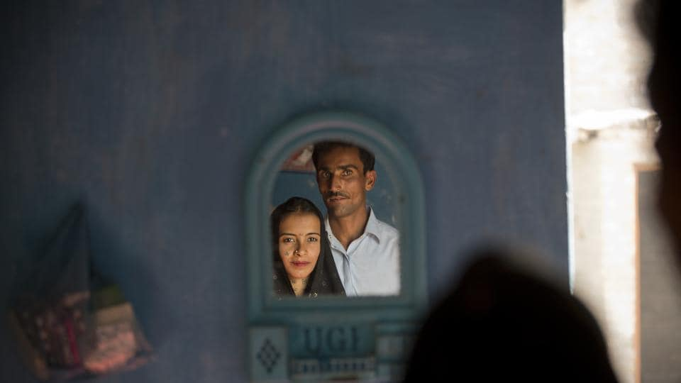 In this photo taken December 1, Hamid Brohi poses for a picture with his wife Jeevti at their home in Pyaro Lundh, Pakistan. The night Jeevti disappeared, her family slept outside to escape Pakistan's brutal summer heat. In the morning, she was gone.