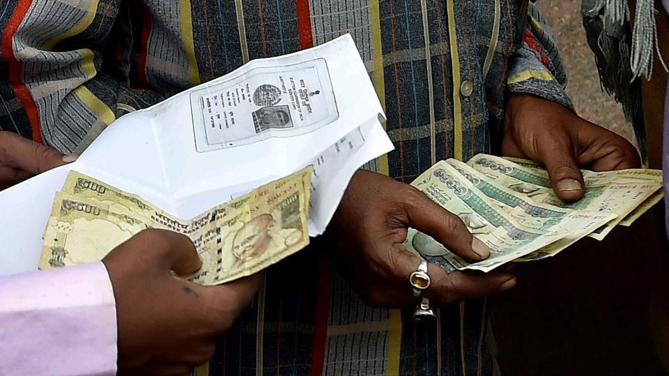People wait outside Reserve Bank to change their old currency notes in Kolkata.
